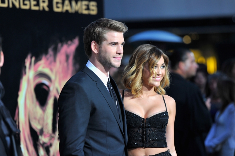 <p>Actors Liam Hemsworth and Miley Cyrus arrive to the premiere of