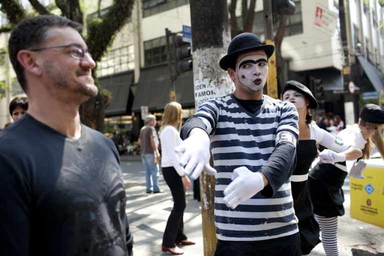 <p>Mimes urge pedestrians to obey the trafic signals during a city campaign to reduce the casualties due to road accidents in Sao Paulo on September 27, 2011. Venezuela is also using mimes to try and stop traffic violations.</p>