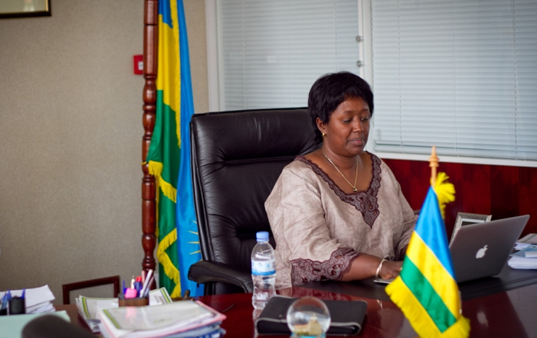 <p>Rwanda's Health Minister, Agnes Binagwaho sits at her desk.</p>