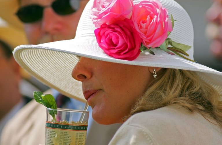 <p>A woman drinks a mint julep during the 132nd Kentucky Derby on May 6, 2006 at Churchill Downs in Louisville, Kentucky.</p>