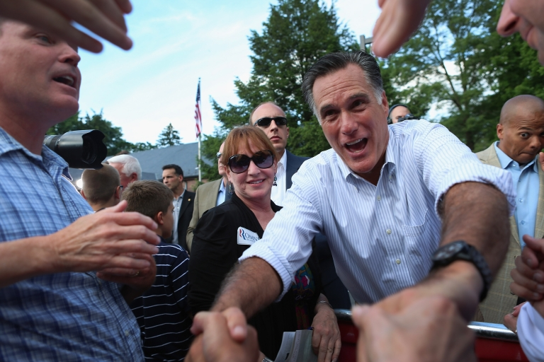 <p>Republican presidential candidate Mitt Romney shakes hands with people during a campaign event. Romney will have to have to find a way to manage voters' demands with the demands of his faith.</p>