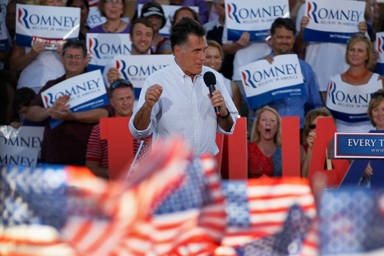 <p>Iowans cheered Mitt Romney at a campaign speech in Davenport. But some complained that the US flags were made in China.</p>
