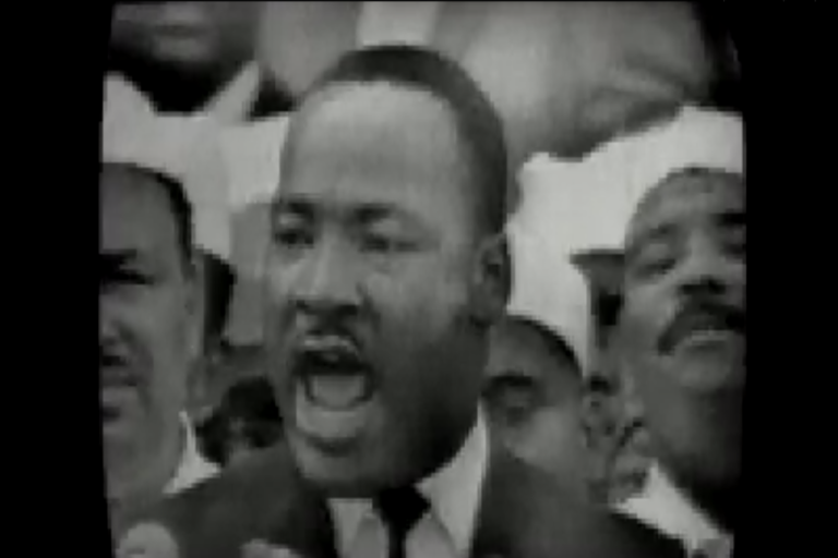<p>A screen grab from a video of Dr. King delivering his speech.</p>