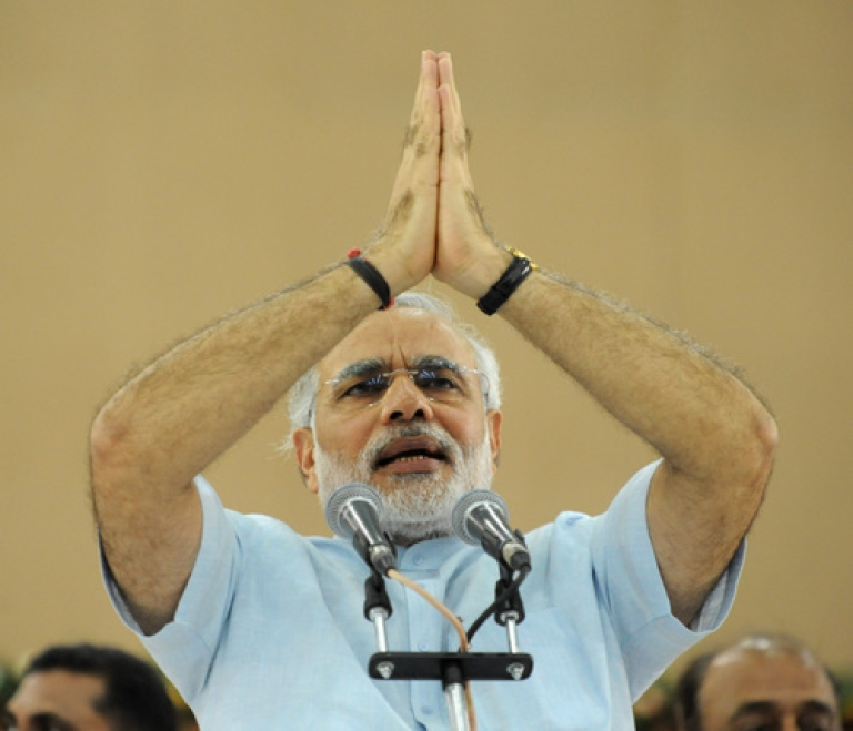 <p>India's Gujarat state Chief Minister Narendra Modi speaks during a ceremony concluding his three-day fast in Ahmedabad on September 19, 2011. Indian Hindu nationalist leader Narendra Modi ended a three-day fast seen as an attempt to bury his controversial past and promote him as a serious prime ministerial contender.</p>