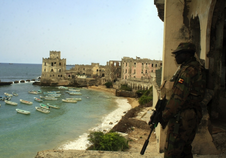 <p>An AMISOM soldier stands guard at Hotel Uruba in Mogadishu on October 24, 2012. Somalia's Al-Qaeda linked Shabab insurgents are on the back foot, reeling from a string of losses as they battle a 17,000-strong African Union force as well as Ethiopian troops and Somali forces. But while the extremist movement is badly damaged a hard core remain a potent threat, linking up with regional Islamist groups and leaving operatives to launch attacks across the south, analysts warn.</p>