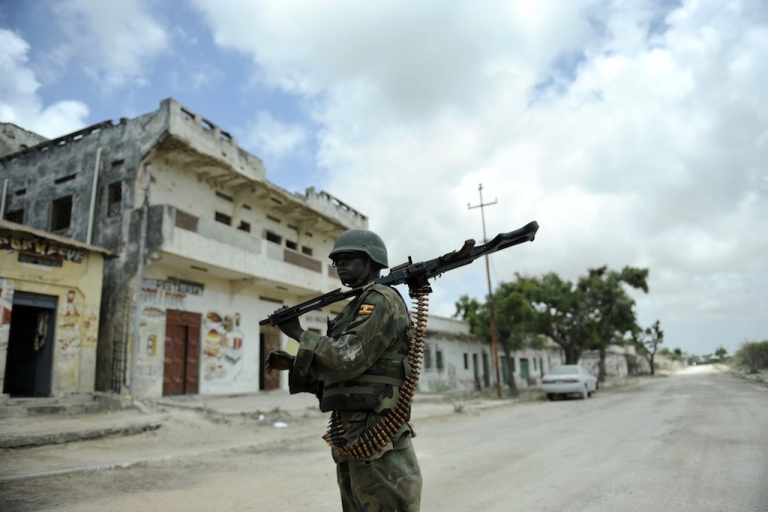 <p>The threat from groups linked to Al Qaeda in Africa and the Middle East is growing.  In this picture taken on Oct. 5, 2011, an officer of the African Union's peacekeeping force in Somalia mans a frontline position near the Mogadishu stadium, captured from Al Shabaab hardline extremists.</p>