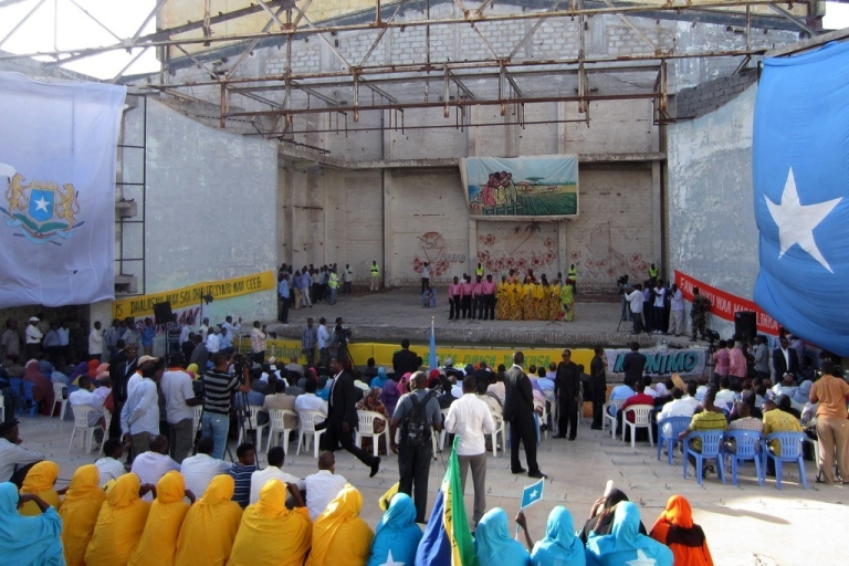 <p>Spectators gather to watch a performance staged by artists at the open-air, Chinese-built Somalia National Theatre which was reopened for the first time in 20 years, on March 19, 2012, in Mogadishu. Just a few weeks later the theater was bombed by Al Shabaab.</p>