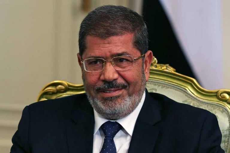 <p>Egyptian President Mohamed Morsi at the Presidential Palace on July 31, 2012 in Cairo.</p>