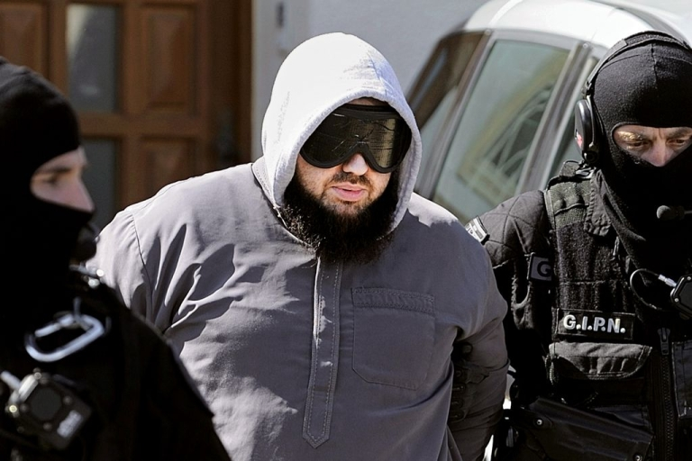 <p>French police arrest the leader of Islamist group Forzane Alizza, Mohamed Achamlane, in Bougenais, western France, on March 30, 2012.</p>