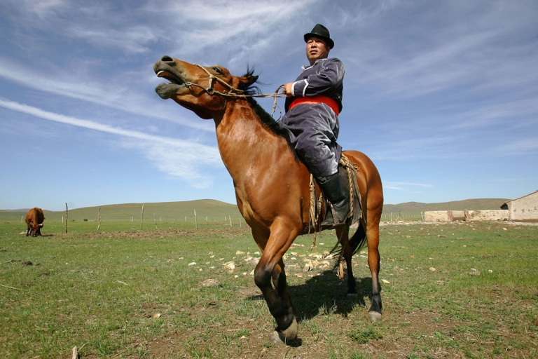 <p>A Mongolian herder rides his horse near his home in Zhenglan County of Xilingguole League, Inner Mongolia Autonomous Region of north China.</p>