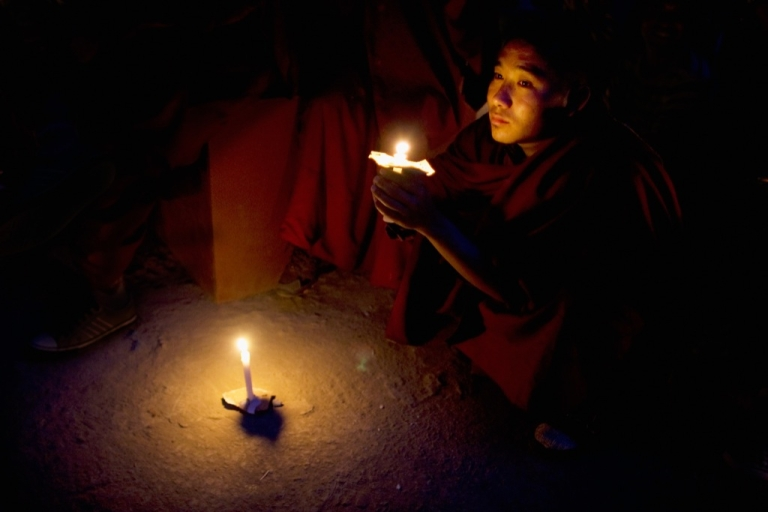 <p>A Tibetan monk in exile looks on during a candle lit vigil to commemorate 50 years in exile on March 10, 2009 in Dharamsala, India. His Holiness the Dalai Lama marks 50 years of exile today in Mcleod Ganj, the seat of the exiled Tibetan government near the town of Dharamsala.</p>