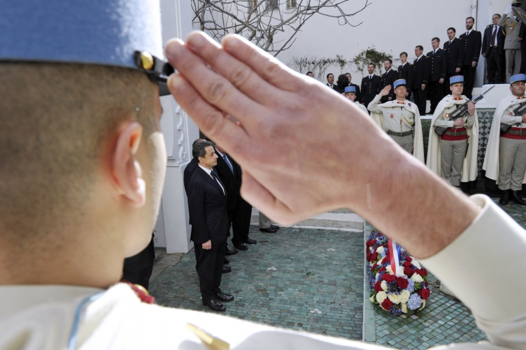 <p>A French soldier salutes as President Nicolas Sarkozy pays tribute to Muslim war veterans who fought for France during a ceremony at the Grand Mosque in Paris on March 14, 2012.</p>