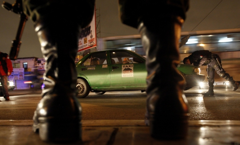 <p>Police check taxis following attacks on taxi drivers in Monterrey earlier this year.</p>