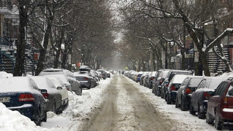 <p>A street in the Plateau Mont-Royal district of Montreal, Canada, is covered with snow on March 15, 2008.</p>