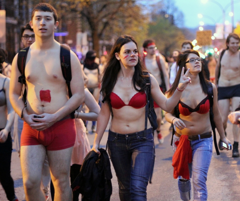 <p>Semi-dressed student protesters march against tuition hikes in Montreal on May 3. Thousands of students paraded in various states of undress through the streets of Montreal in opposition to tuition hikes.</p>