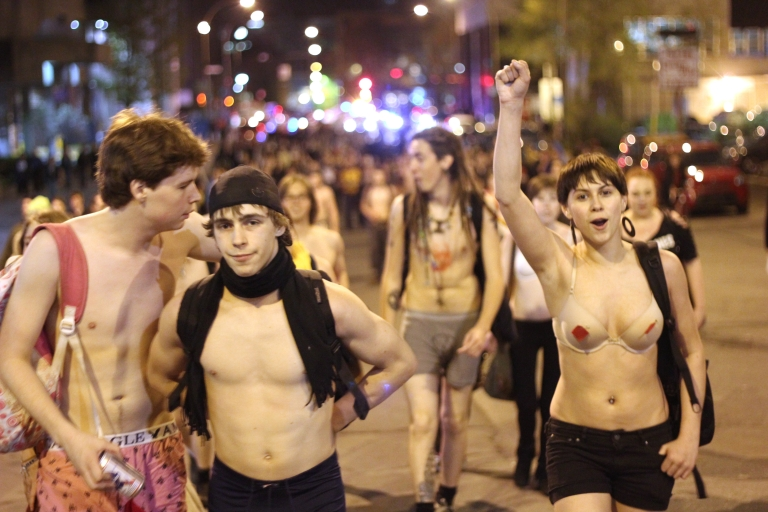 <p>Nearly naked student protesters march against tuition hikes in Montreal on May 3, 2012. Thousands of students paraded in various states of undress through the streets of Montreal in opposition to tuition hikes.</p>
