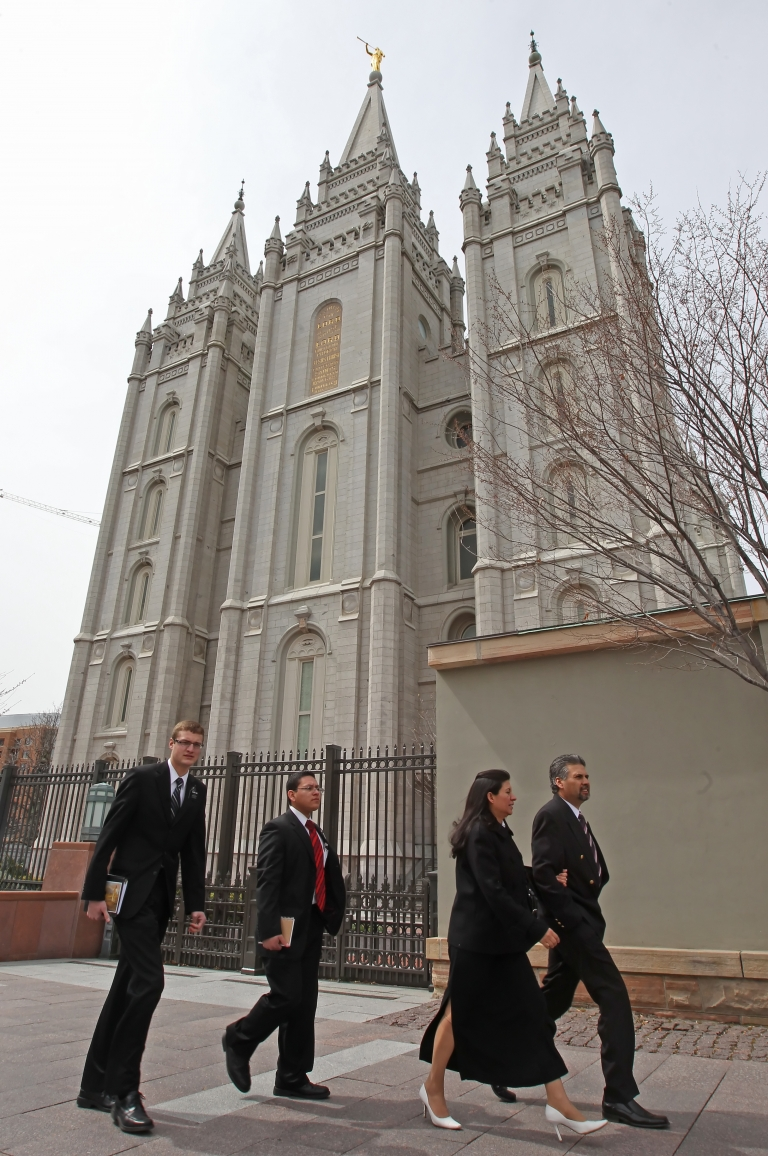 <p>Mormon faithful walk past the historic Salt Lake Temple in Salt Lake City, Utah, on their way to the 180th Annual General Conference of the church on April 3, 2010.</p>