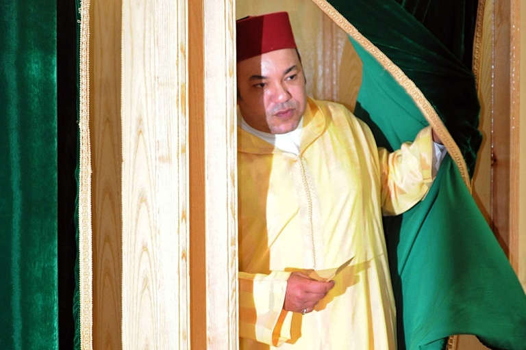 <p>Morocco King Mohammed VI leaves a polling booth to vote in a referendum on curbing his near absolute powers on July 1, 2011 in Rabat. The King has offered reforms following protests inspired by pro-democracy uprisings around the Arab world.</p>