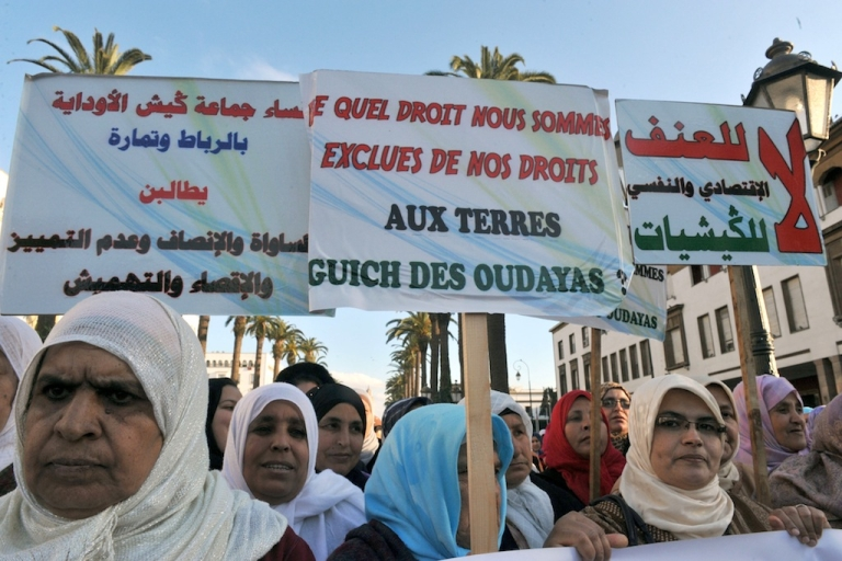 <p>Moroccan women attend a rally during International Women's Day in Rabat in 2011. The poster reads 'We are denied the rights to our land'. Women across tribal areas are seeking changes in laws that would allow them to inherit family land.</p>