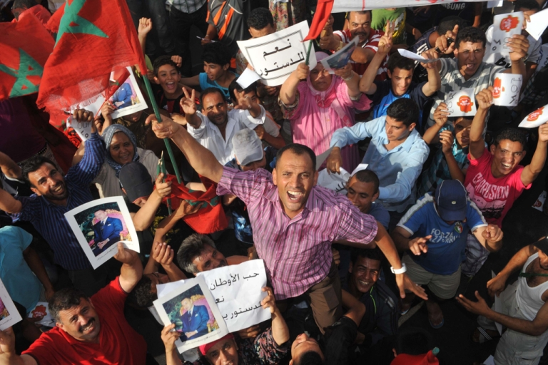 <p>Thousands of Moroccans take part in a rally to support the new constitution proposed by King Mohammed VI. The constitution will be voted on in a national referendum on July 1. Pro-democracy demonstrators have rejected the king's constitutional reforms.</p>