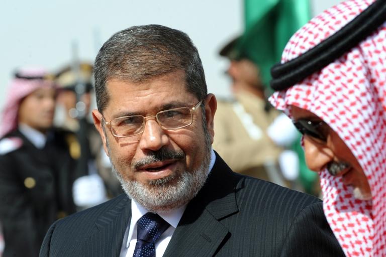 <p>Egypt's President Mohamed Morsi (L) speaks with Saudi Emir Mohammed Bin Saad Bin Abdulaziz, acting deputy Emir of the Riyadh region upon his arrival at Riyadh airport to attend the third Arab Economic, Social and Development Summit, on January 21, 2013 in Riyadh.</p>