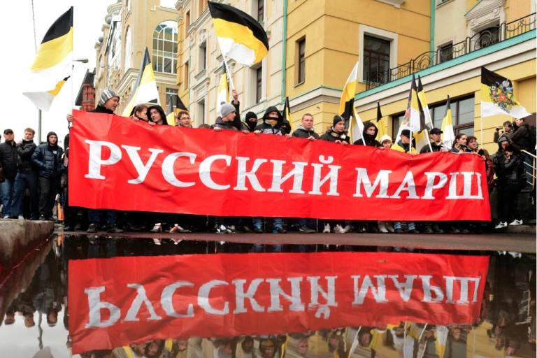 <p>Russian ultra-nationalists wave Russian Empire's black-yellow-white flags and hold banner as they take part in the so-called 'Russian March' in central Moscow on November 4, 2012, marking the National Unity Day. The annual Russian March is timed to coincide with the Day of Popular Unity, a national holiday which this year marks the 400th anniversary of the 1612 expulsion of Polish occupiers from the Kremlin in Moscow. Members of nationalist movements of all hues will take to the streets as Putin, who returned to the Kremlin for a third term in May, is struggling with the worst political crisis since he came to power 12 years ago.</p>