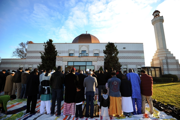 <p>Muslim devotees take part in a special morning prayer to mark the start of the Eid-al-Adha festival on Nov. 6, 2011, at a mosque in Silver Spring, Md.</p>