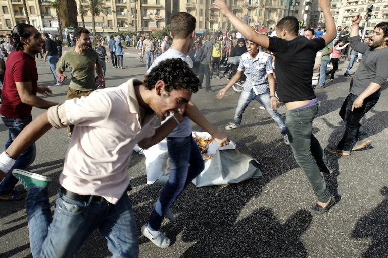 <p>Egyptian anti-Mubarak protesters demonstrate in Cairo's Tahrir square on June 2, 2012. Egypt's Muslim Brotherhood called for mass protests after a court sentenced ousted President Hosni Mubarak and his interior minister to life in prison but acquitted six security chiefs in the deaths of protesters last year.</p>