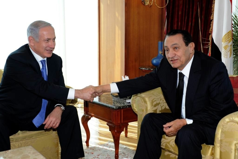 <p>Egypt's former president, Hosni Mubarak (right), reportedly suffers from stomach cancer and his health is deteriorating quickly.  Seen here shaking hands with Israeli Prime Minister Benjamin Netanyahu in January, Mubarak has since stepped down and could soon be executed if convicted of ordering the killings of protesters in January.</p>