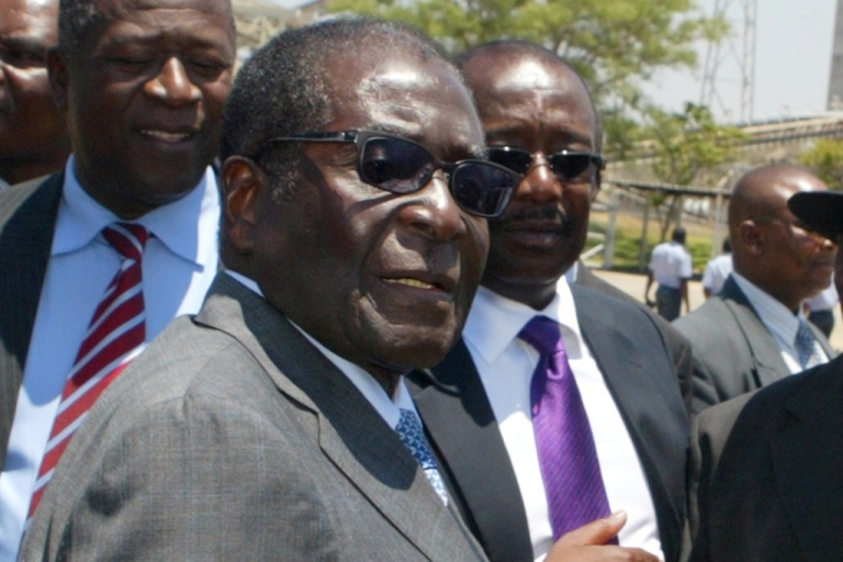 <p>Zimbabwe's President Robert Mugabe has been angered by a satirical television advertisement by Nando's chicken. Here Mugabe greets local chiefs at Zimplats mine, outside Harare, on October 13, 2011, where he launched a community ownership trust.</p>