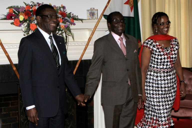 <p>Zimbabwe President Robert Mugabe (C) together with the first lady Grace Mugabe (R) greets the Equitorial Guinea's President Teodoro Obiang Nguema (L) upon his arrival at the Zimbabwe State House in Harare on Janaury 9, 2012. Africa's longest-ruling leader, Equatorial Guinea's Teodoro Obiang Nguema, on Monday made an unannounced visit to Zimbabwe and pleged to increase cooperation between the two countries.</p>
