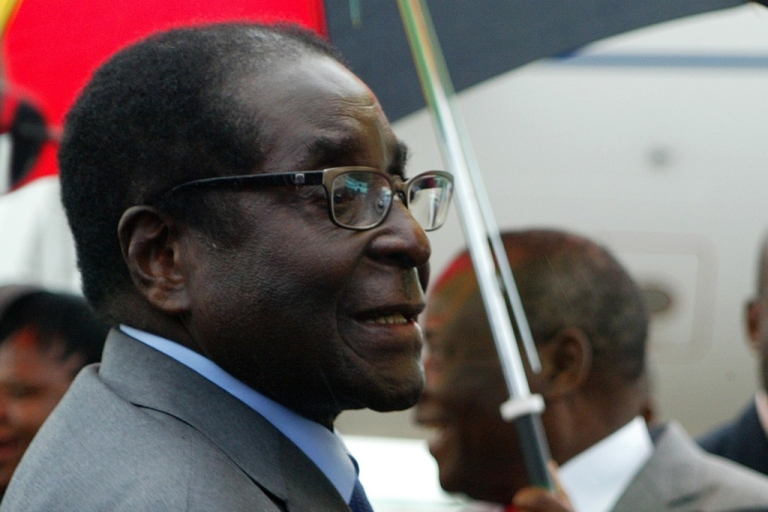 <p>Zimbabwean President Robert Mugabe, 88, at Harare airport on his return to Zimbabwe on April 12, 2012. Mugabe's healthy appearance quashed rumors that he was deathly ill.</p>