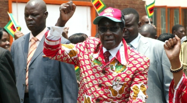 <p>Pretty in pink. Zimbabwe President and leader of ZANU PF Robert Mugabe arrives at the party's 12th National People's Conference in Bulawayo, on December 8, 2011.</p>