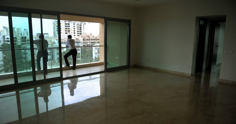 <p>Indian sales executives take in the view from a luxury high-rise in Mumbai. Mumbai developers have been busy building dream homes for a rapidly-growing list of Indian millionaires, and property prices have skyrocketed.</p>