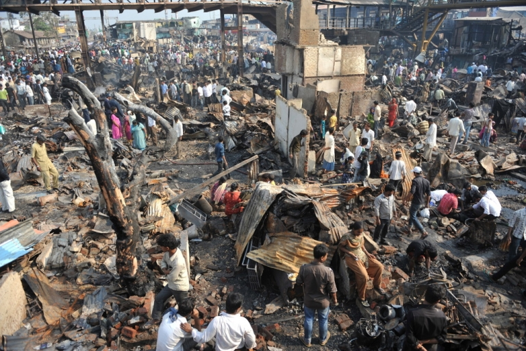 <p>Residents hunt for usable items from the burnt remains of a slum area in Mumbai on March 5, 2011.  A major fire gutted a large slum settlement, home to hundreds of residents, next to Bandra station in Mumbai's suburbs.  No casualties were reported.</p>