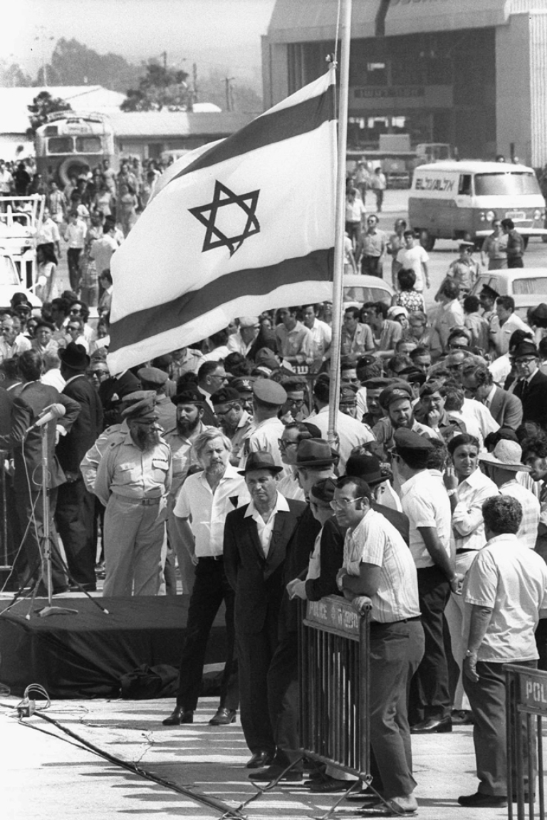 <p>Israel's national flag flies at half-mast as the coffins of the 11 Israeli athletes murdered by Palestinian terrorists in the Munich Olympics arrive September 7, 1972 at the international airport at Lod, near Tel Aviv, Israel.</p>