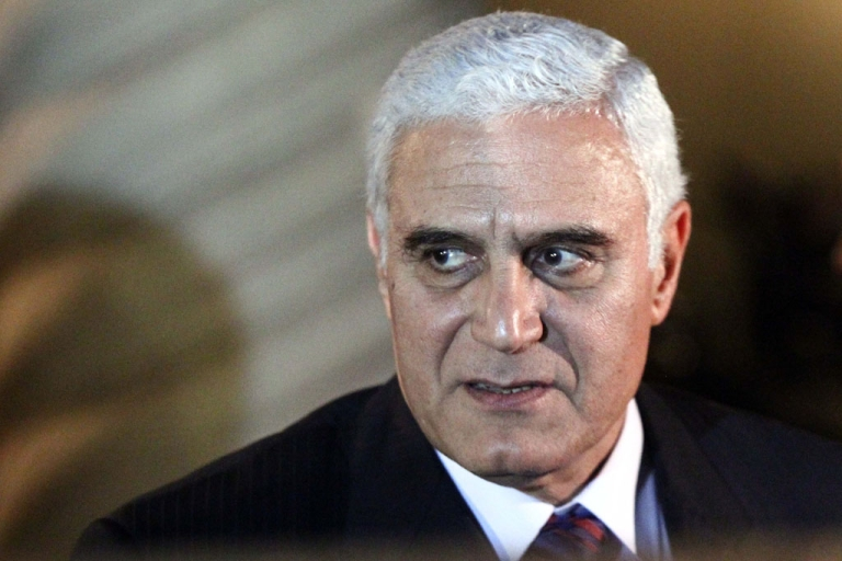 <p>Egyptian intelligence chief General Murad Muwafi leaves a meeting between Palestinian Authority President Mahmud Abbas and Hamas leader Khaled Meshaal in Cairo on February 23, 2012.</p>