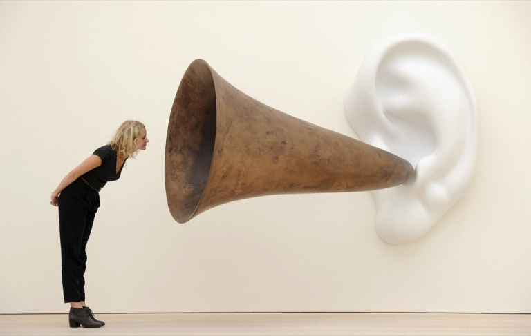 <p>An employees poses next to an installation by US artist John Baldessari entitled 'Beethoven's Trumpet (With Ear)' at the Saatchi Gallery in central London on May 26, 2011.</p>