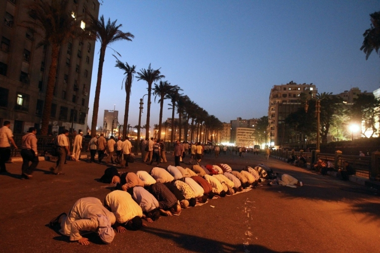 <p>Egyptian supporters of Muslim Brotherhood presidential candidate Mohammed Morsi pray in Cairo's Tahrir Square on June 19, 2012.</p>
