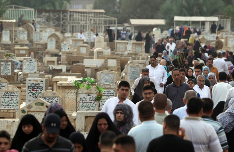 <p>Iraqi Sunni Muslims visit the al-Ghazali cemetery in Baghdad on the first day of Eid al-Adha on October 26, 2012.</p>