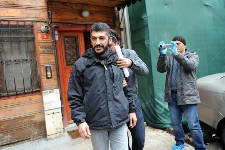 <p>Agence France-Presse photographer Mustafa Ozer (L) is escorted by a plainclothes policeman as he leaves his house in Istanbul, on December 20, 2011. Police detained at least 38 people, most of them journalists, in dawn raids across Turkey as part of an investigation into alleged links between Kurdish activists and armed separatist militants, security officials and media said.</p>