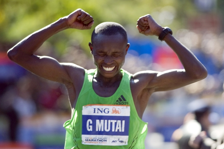 <p>Geoffrey Mutai of Kenya reacts as he crosses the finish line to win the ING New York City Marathon on Nov. 6, 2011, in New York.</p>