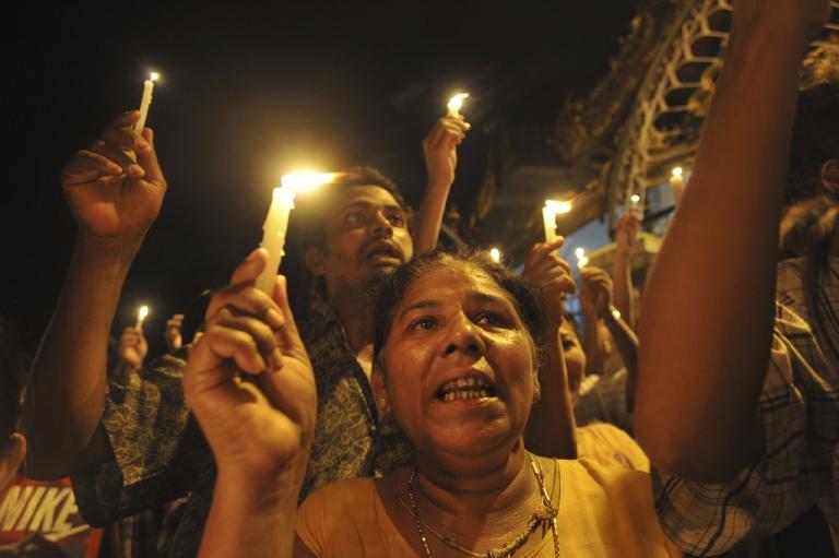 <p>Demonstrators in Myanmar protest against severe power cuts at Sule pagoda in Yangon, May 22, 2012.</p>
