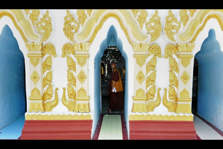 <p>A monk visits a pagoda in Mandalay on May 29, 2012 . The International Monetary Fund said on May 7 that Myanmar could be Asia's next boom economy if the country sticks to its new path of political and economic reforms.</p>