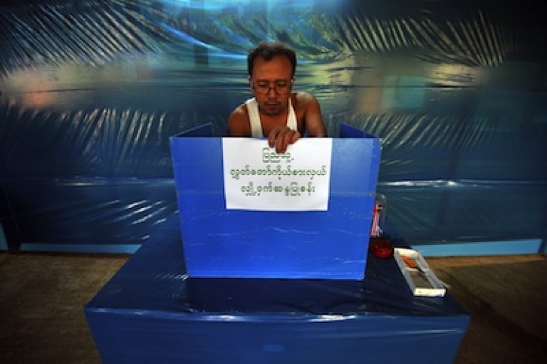 <p>An Election Commission employee makes final preparations at a polling station in Yangon on March 31, 2012.</p>