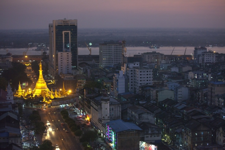 <p>Rush hour traffic moves near by the Sule Pagoda at dusk in Yangon, Myanmar.</p>