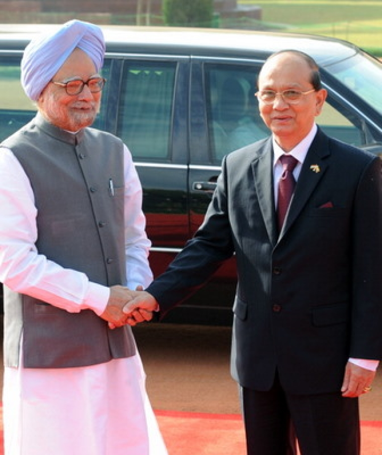 <p>Indian Prime Minister Manmohan Singh (L) shakes hands with President of Myanmar U Thein Sein (R) during a full state welcome at the Presidential palace in New Delhi on October 14, 2011. India rolled out the red carpet for visiting Myanmar President Thein Sein, sensing a chance to deepen relations with a neighbour traditionally allied to New Delhi's regional rival Beijing. The former general, who arrived in India on October 12 and spent two days touring Buddhist pilgrimage sites, before reaching New Delhi for the official leg of his three-day visit.</p>