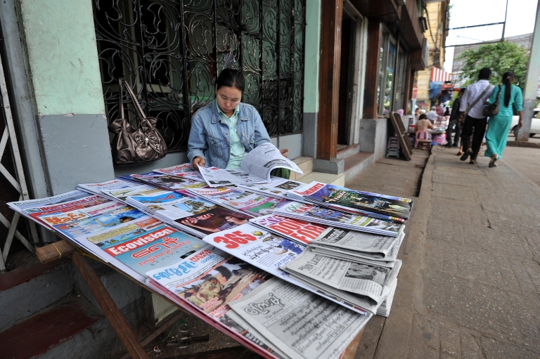 <p>A Myanmar newspapers vendor waits for customers in downtown Yangon on March 19, 2011, which felt tremors from a6.8-magnitude earthquake Thursday.</p>