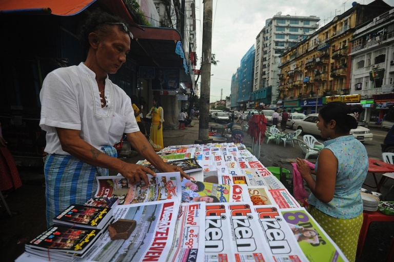 <p>A Myanmar vendor sells local journals and newspapers on a road side in Yangon on Aug. 20, 2012. Strong economic growth could lift Myanmar to the rank of middle income nation by 2030 if the formerly army-ruled country overcomes a host of reform challenges, the Asian Development Bank said on Aug. 20.</p>