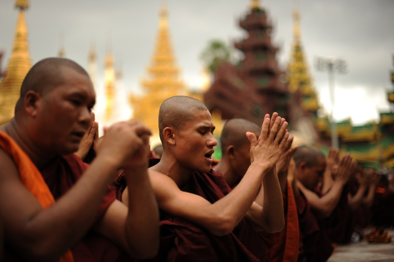 <p>Rakhine Buddhist monks pray as hundreds of demonstrators gather at the Shwedagon pagoda after unrest flared in the western Myanmar state and at least seven people were killed, in Yangon on June 10, 2012.  Myanmar on June 10 imposed a curfew in the Rakhine state capital Sittwe, state media reported, amid fears of further unrest following deadly sectarian rioting between Buddhists and Muslims.</p>